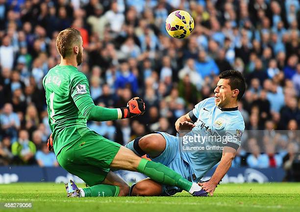 Sergio Aguero of Manchester City collides with David De Gea of Manchester United during the Barclays Premier League match between Manchester City and...