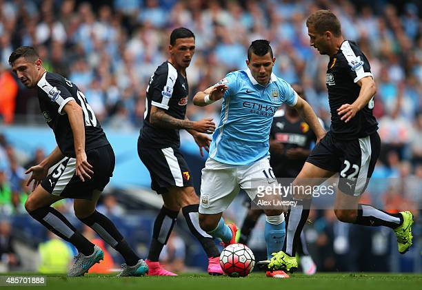 Sergio Aguero of Manchester City competes against Craig Cathcart Jose Holebas and Almen Abdi of Watford during the Barclays Premier League match...