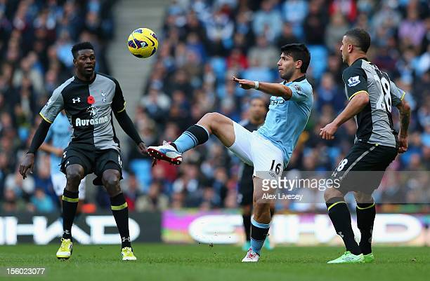 Sergio Aguero of Manchester City competes with Kyle Walker of Tottenham Hotspur during the Barclays Premier League match between Manchester City and...