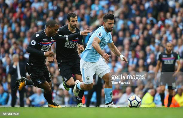 Sergio Aguero of Manchester City controls the ball under pressure of Ruben LoftusCheek and Luka Milivojevic of Crystal Palace during the Premier...