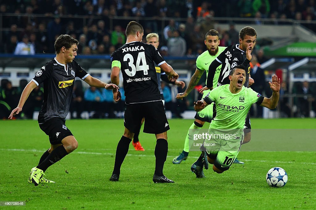Sergio Aguero of Manchester City draws a foul by Fabian Johnson of Borussia Monchengladbach to win a penalty during the UEFA Champions League Group D match between VfL Borussia Monchengladbach and Manchester City at the Borussia Park Stadium on September 30, 2015 in Moenchengladbach, Germany.