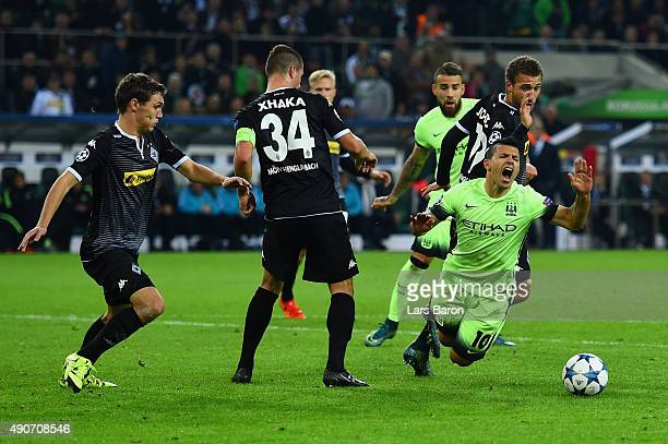 Sergio Aguero of Manchester City draws a foul by Fabian Johnson of Borussia Monchengladbach to win a penalty during the UEFA Champions League Group D...