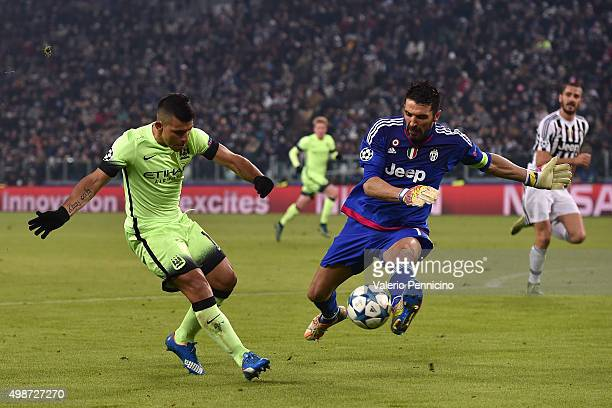Sergio Aguero of Manchester City FC in action against Gianluigi Buffon of Juventus during the UEFA Champions League group stage match between...