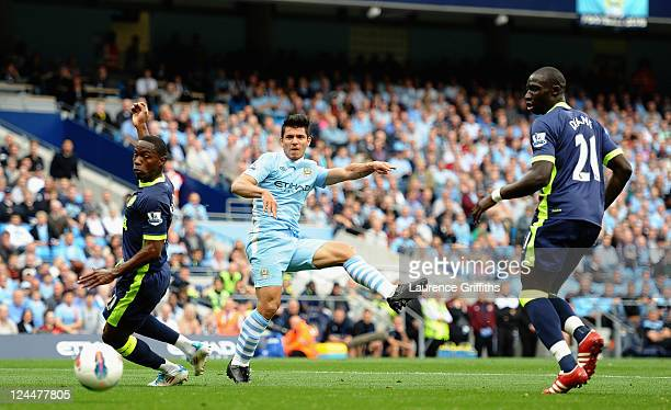 Sergio Aguero of Manchester city fires home the first goal during the Barclays Premier League match between Manchester City and Wigan Athletic at...
