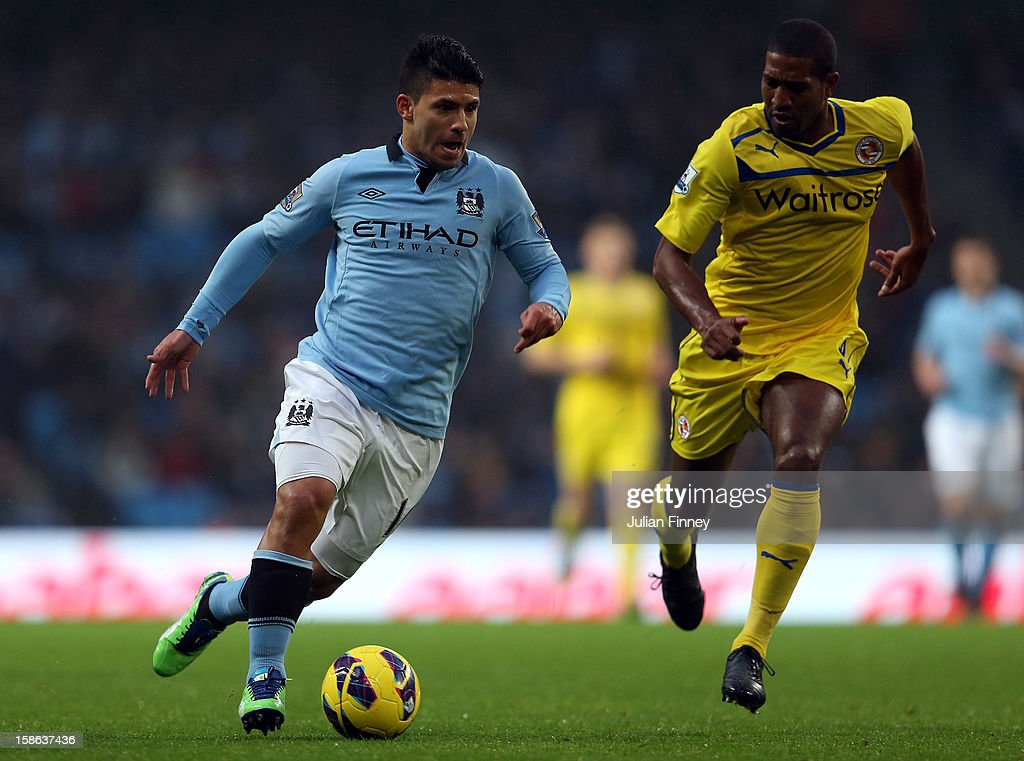<a gi-track='captionPersonalityLinkClicked' href=/galleries/search?phrase=Sergio+Aguero&family=editorial&specificpeople=1100704 ng-click='$event.stopPropagation()'>Sergio Aguero</a> of Manchester City goes past <a gi-track='captionPersonalityLinkClicked' href=/galleries/search?phrase=Mikele+Leigertwood&family=editorial&specificpeople=224769 ng-click='$event.stopPropagation()'>Mikele Leigertwood</a> of Reading during the Barclays Premier League match between Manchester City and Reading at Etihad Stadium on December 22, 2012 in Manchester, England.