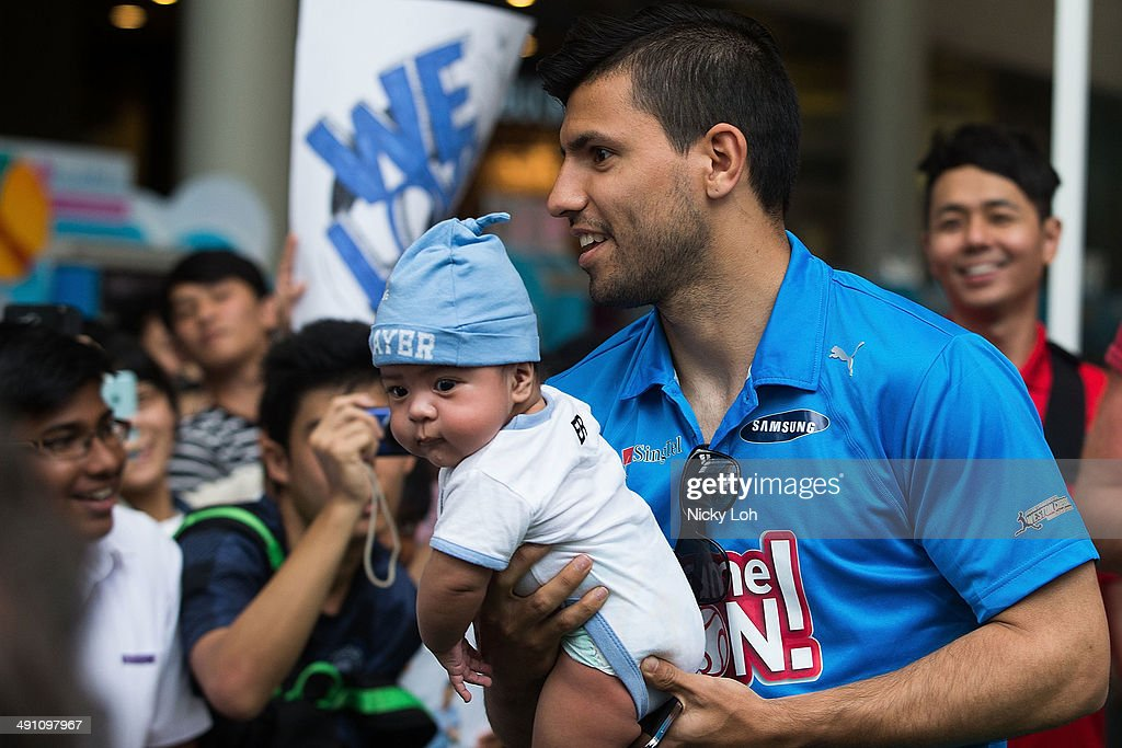 <a gi-track='captionPersonalityLinkClicked' href=/galleries/search?phrase=Sergio+Aguero&family=editorial&specificpeople=1100704 ng-click='$event.stopPropagation()'>Sergio Aguero</a> of Manchester City greets supporters during a meet-the-fans session on May 16, 2014 in Singapore.