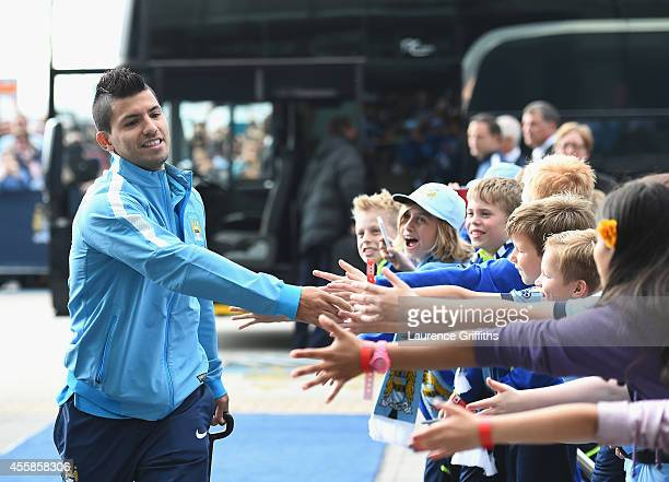 Sergio Aguero of Manchester City greets the fans on arrival prior to the Barclays Premier League match between Manchester City and Chelsea at Etihad...