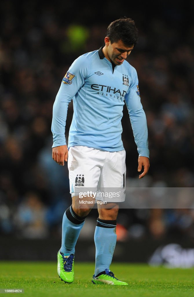 Sergio Aguero of Manchester City grimaces during the Barclays Premier League match between Manchester City and Stoke City at the Etihad Stadium on January 1, 2013 in Manchester, England.