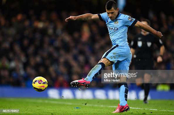 Sergio Aguero of Manchester City has a shot at goal which is diverted by teammate David Silva into the net during the Barclays Premier League match...