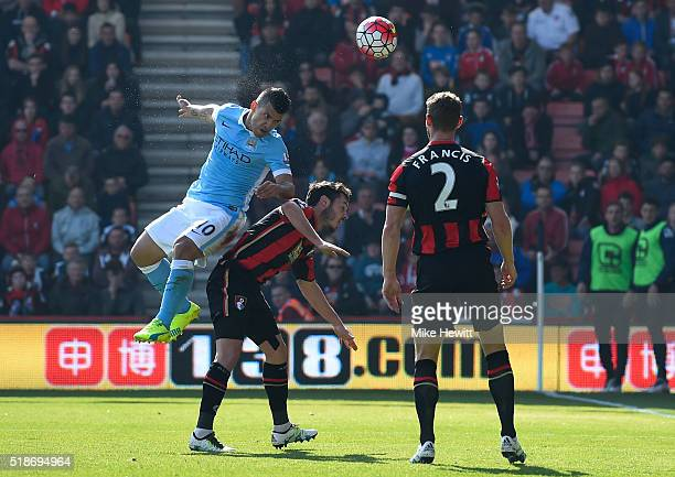 Sergio Aguero of Manchester City heads the ball to score his team's third goal during the Barclays Premier League match between AFC Bournemouth and...