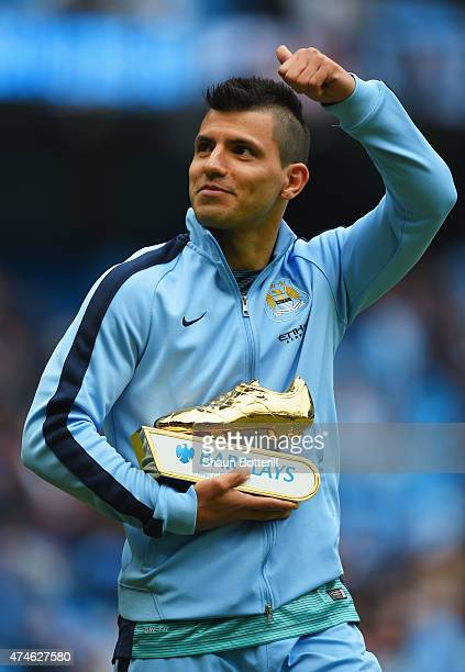Sergio Aguero of Manchester City holding the golden boots trophy waves to supporters after the Barclays Premier League match between Manchester City...