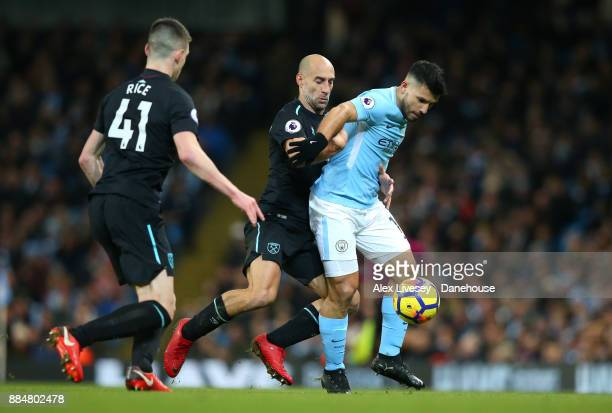 Sergio Aguero of Manchester City holds off a challenge from Pablo Zabaleta of West Ham United during the Premier League match between Manchester City...