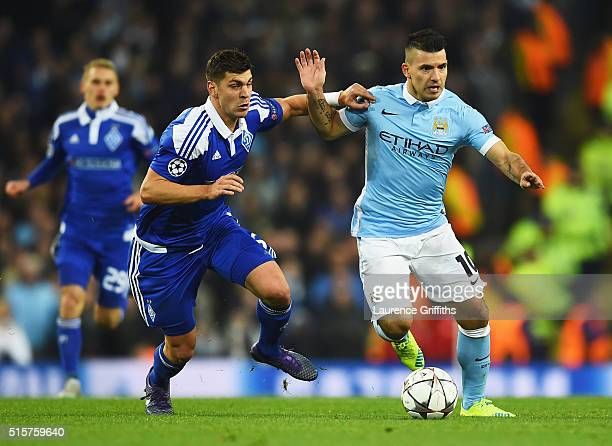 Sergio Aguero of Manchester City holds off Aleksandar Dragovic of Dynamo Kiev during the UEFA Champions League round of 16 second leg match between...