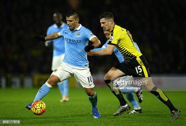 Sergio Aguero of Manchester City holds off Craig Cathcart of Watford during the Barclays Premier League match between Watford and Manchester City at...