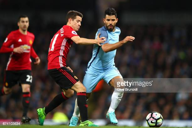 Sergio Aguero of Manchester City holds off pressure from Ander Herrera of Manchester United during the Premier League match between Manchester City...