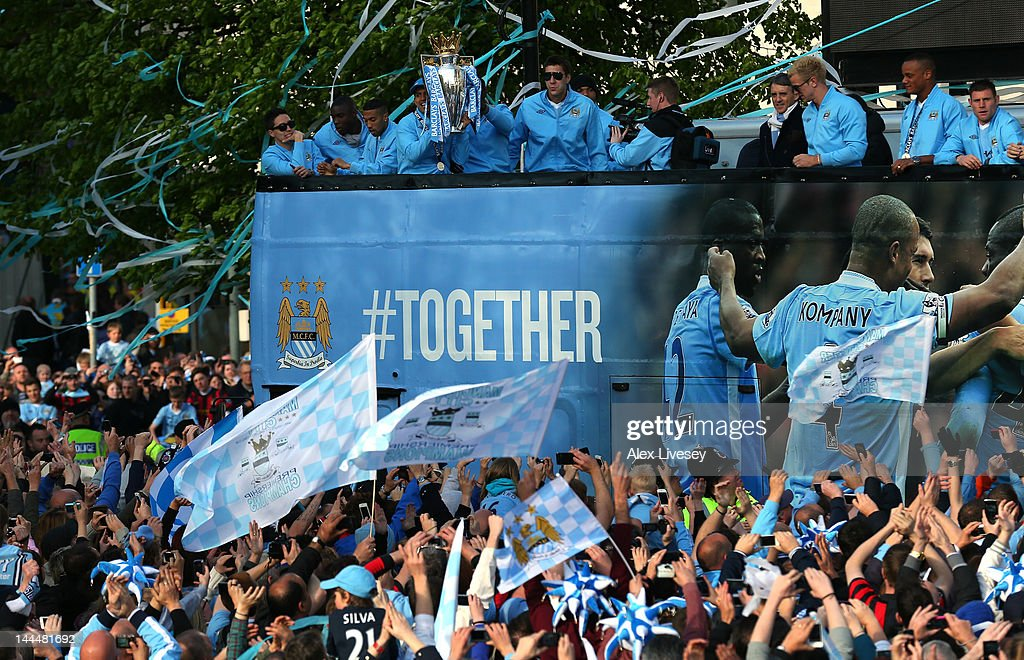<a gi-track='captionPersonalityLinkClicked' href=/galleries/search?phrase=Sergio+Aguero&family=editorial&specificpeople=1100704 ng-click='$event.stopPropagation()'>Sergio Aguero</a> of Manchester City holds the Barclays Premier League trophy as the players of Manchester City leave Manchester Town Hall in an open top bus for the start of their victory parade around the streets of Manchester on May 14, 2012 in Manchester, England.