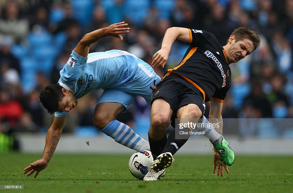 <a gi-track='captionPersonalityLinkClicked' href=/galleries/search?phrase=Sergio+Aguero&family=editorial&specificpeople=1100704 ng-click='$event.stopPropagation()'>Sergio Aguero</a> of Manchester City in action with <a gi-track='captionPersonalityLinkClicked' href=/galleries/search?phrase=Kevin+Doyle+-+Soccer+Player&family=editorial&specificpeople=661496 ng-click='$event.stopPropagation()'>Kevin Doyle</a> of Wolverhampton Wanderers during the Barclays Premier League match between Manchester City and Wolverhampton Wanderers at Etihad Stadium on October 29, 2011 in Manchester, England.