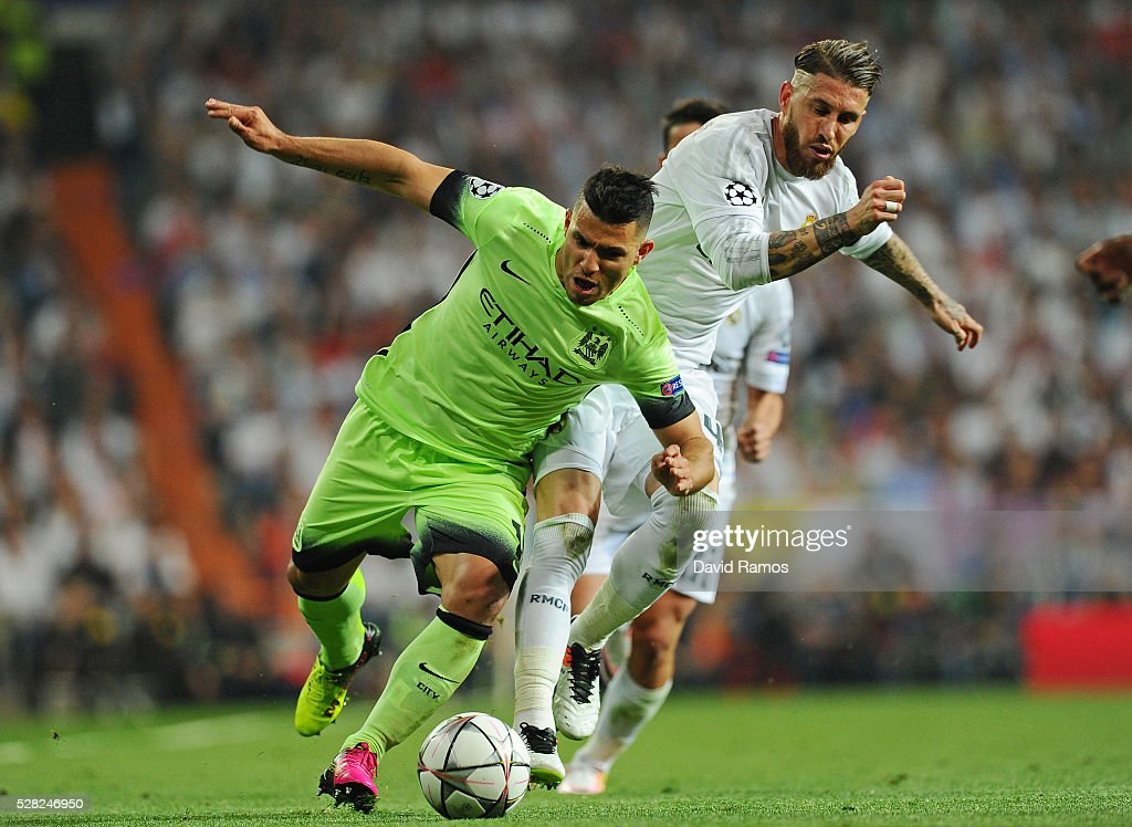 <a gi-track='captionPersonalityLinkClicked' href=/galleries/search?phrase=Sergio+Aguero&family=editorial&specificpeople=1100704 ng-click='$event.stopPropagation()'>Sergio Aguero</a> of Manchester City is challenegd by Sergio Ramos of Real Madrid during the UEFA Champions League semi final, second leg match between Real Madrid and Manchester City FC at Estadio Santiago Bernabeu on May 4, 2016 in Madrid, Spain.