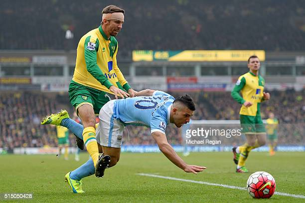 Sergio Aguero of Manchester City is challenged by Gary O'Neil of Norwich City during the Barclays Premier League match between Norwich City and...