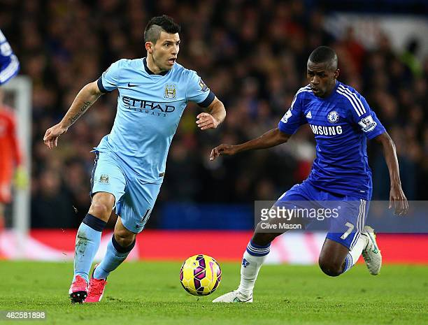 Sergio Aguero of Manchester City is challenged by Ramires of Chelsea during the Barclays Premier League match between Chelsea and Manchester City at...