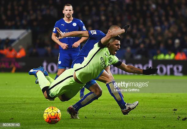 Sergio Aguero of Manchester City is challenged in the penalty area by Gokhan Inler of Leicester City during the Barclays Premier League match between...
