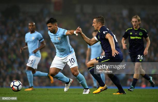 Sergio Aguero of Manchester City is chased dowb by Phil Jagielka of Everton during the Premier League match between Manchester City and Everton at...