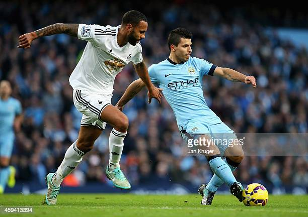Sergio Aguero of Manchester City is closed down by Kyle Bartley of Swansea City during the Barclays Premier League match between Manchester City and...