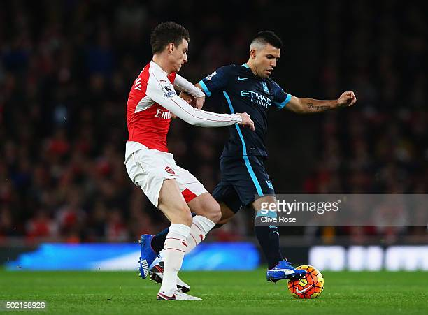 Sergio Aguero of Manchester City is closed down by Laurent Koscielny of Arsenal during the Barclays Premier League match between Arsenal and...