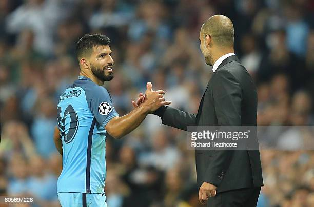 Sergio Aguero of Manchester City is congratulated by Josep Guardiola during the UEFA Champions League match between Manchester City FC and VfL...