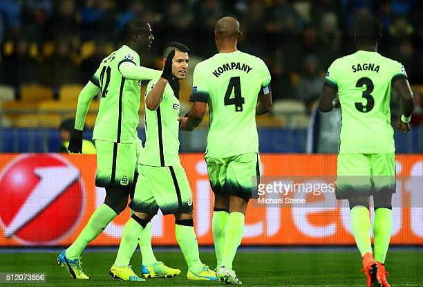 Sergio Aguero of Manchester City is congratulated by teammates Yaya Toure and Vincent Kompany after scoring the opening goal during the UEFA...