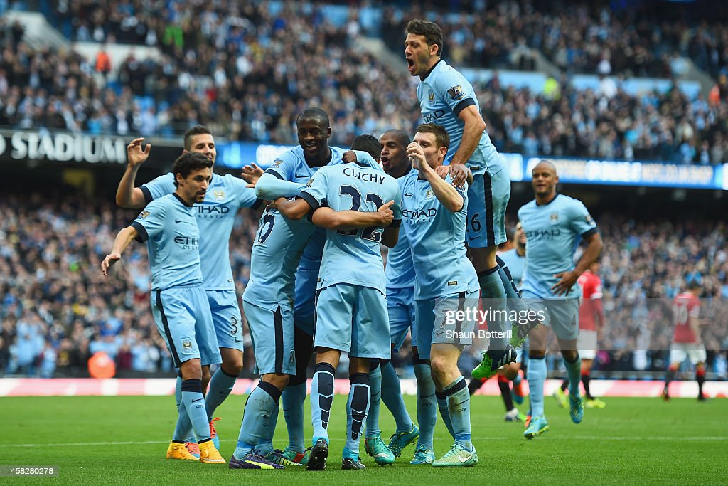 <a gi-track='captionPersonalityLinkClicked' href=/galleries/search?phrase=Sergio+Aguero&family=editorial&specificpeople=1100704 ng-click='$event.stopPropagation()'>Sergio Aguero</a> of Manchester City is mobbed by team mates after scoring the opening goal during the Barclays Premier League match between Manchester City and Manchester United at Etihad Stadium on November 2, 2014 in Manchester, England.
