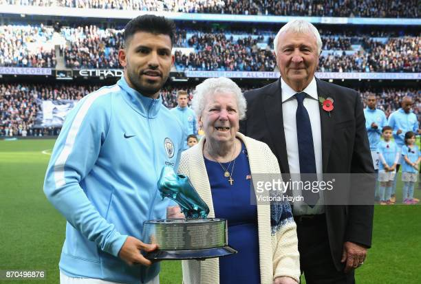 Sergio Aguero of Manchester City is presented with the a award for becoming Manchester City's all time top goal soccer by Mike Summerbee prior to the...