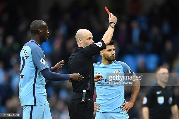 Sergio Aguero of Manchester City is shown a red card by referee Anthony Taylor after fouling David Luiz of Chelsea during the Premier League match...