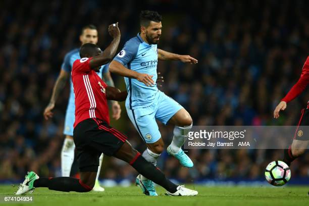 Sergio Aguero of Manchester City is tackled by Eric Bailly of Manchester United during the Premier League match between Manchester City and...