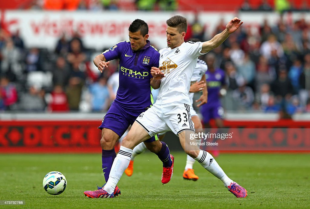 <a gi-track='captionPersonalityLinkClicked' href=/galleries/search?phrase=Sergio+Aguero&family=editorial&specificpeople=1100704 ng-click='$event.stopPropagation()'>Sergio Aguero</a> of Manchester City is tackled by Federico Fernandez of Swansea City during the Barclays Premier League match between Swansea and Manchester City at the Liberty Stadium on May 17, 2015 in Swansea, Wales.