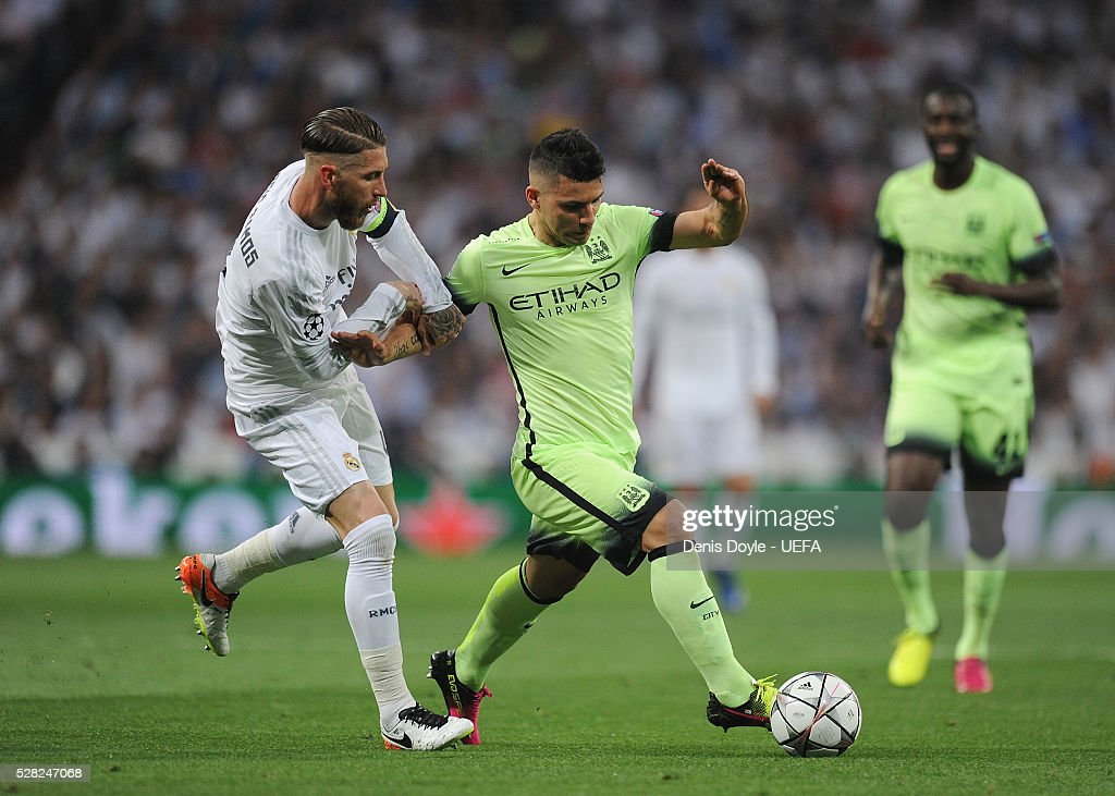Sergio Aguero of Manchester City is tackled by <a gi-track='captionPersonalityLinkClicked' href=/galleries/search?phrase=Sergio+Ramos+-+Jugador+de+f%C3%BAtbol&family=editorial&specificpeople=491009 ng-click='$event.stopPropagation()'>Sergio Ramos</a> of Real Madrid during the UEFA Champions League Semi Final second leg match between Real Madrid and Manchester City FC at Estadio Santiago Bernabeu on May 4, 2016 in Madrid, Spain.