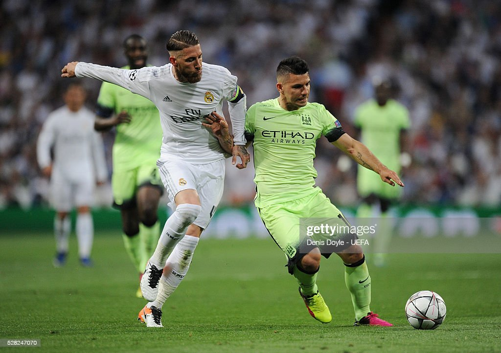 Sergio Aguero of Manchester City is tackled by Sergio Ramos of Real Madrid during the UEFA Champions League Semi Final second leg match between Real Madrid and Manchester City FC at Estadio Santiago Bernabeu on May 4, 2016 in Madrid, Spain.