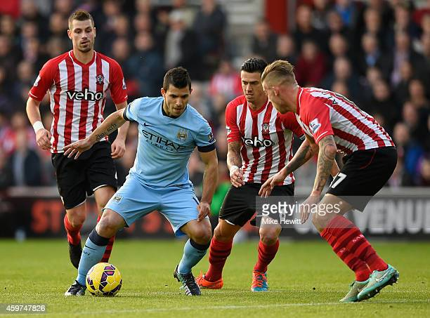 Sergio Aguero of Manchester City is tightly marked during the Barclays Premier League match between Southampton and Manchester St Mary's Stadium on...