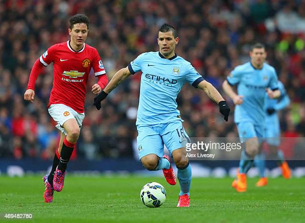 Sergio Aguero of Manchester City is watched by Ander Herrera of Manchester United during the Barclays Premier League match between Manchester United...
