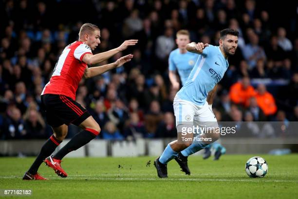Sergio Aguero of Manchester City is watched by Sven van Beek of Feyenoord during the UEFA Champions League group F match between Manchester City and...
