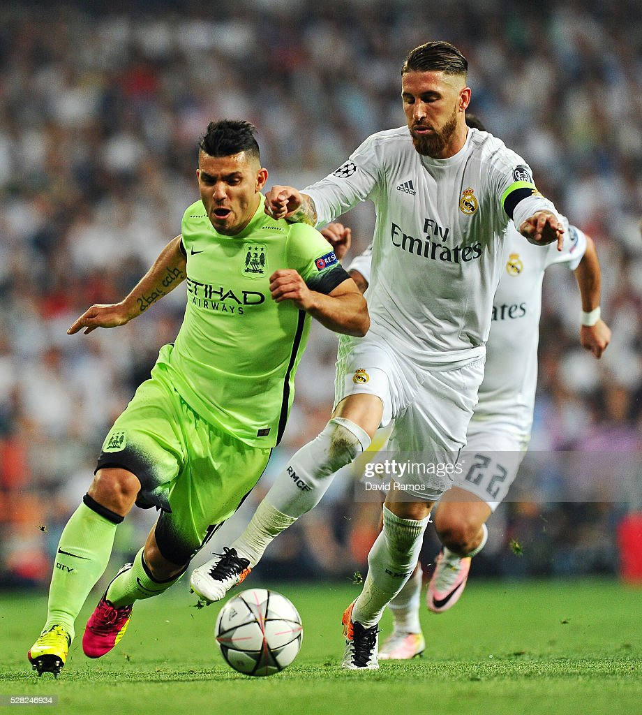 <a gi-track='captionPersonalityLinkClicked' href=/galleries/search?phrase=Sergio+Aguero&family=editorial&specificpeople=1100704 ng-click='$event.stopPropagation()'>Sergio Aguero</a> of Manchester City ius challenegd by Sergio Ramos of Real Madrid during the UEFA Champions League semi final, second leg match between Real Madrid and Manchester City FC at Estadio Santiago Bernabeu on May 4, 2016 in Madrid, Spain.