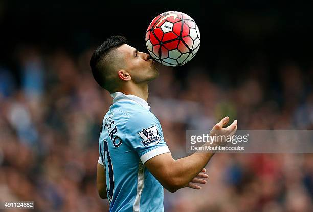 Sergio Aguero of Manchester City kisses the ball to celebrate a goal during the Barclays Premier League match between Manchester City and Newcastle...