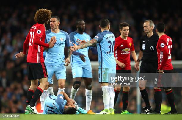 Sergio Aguero of Manchester City lays on the floor following a clash with Marouane Fellaini of Manchester United during the Premier League match...