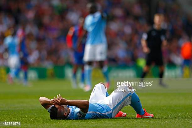 Sergio Aguero of Manchester City lies on the ground injured during the Barclays Premier League match between Crystal Palace and Manchester City at...