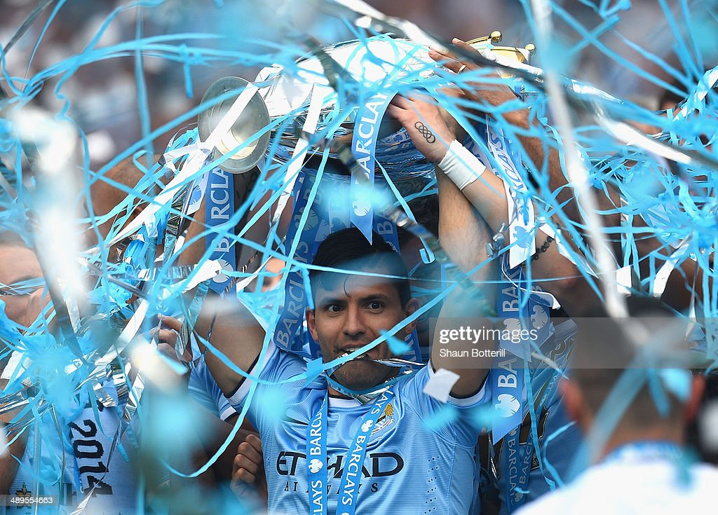 Sergio Aguero of Manchester City lifts the Premier League trophy at the end of the Barclays Premier League match between Manchester City and West Ham United at the Etihad Stadium on May 11, 2014 in Manchester, England.