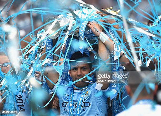Sergio Aguero of Manchester City lifts the Premier League trophy at the end of the Barclays Premier League match between Manchester City and West Ham...