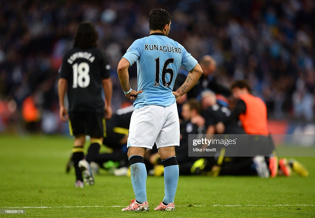Sergio Aguero of Manchester City looks dejected in defeat as Wigan Athletic playes celebrate the FA Cup with Budweiser Final between Manchester City and Wigan Athletic at Wembley Stadium on May 11, 2013 in London, England.