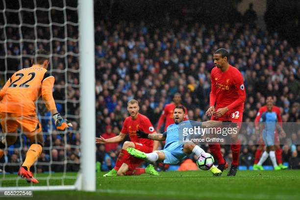 Sergio Aguero of Manchester City misses a chance during the Premier League match between Manchester City and Liverpool at Etihad Stadium on March 19...