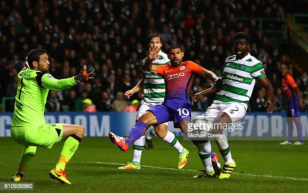 Sergio Aguero of Manchester City misses a chance under pressure from Kolo Toure of Celtic during the UEFA Champions League group C match between...