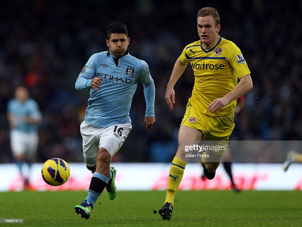 <a gi-track='captionPersonalityLinkClicked' href=/galleries/search?phrase=Sergio+Aguero&family=editorial&specificpeople=1100704 ng-click='$event.stopPropagation()'>Sergio Aguero</a> of Manchester City runs for the ball with Alex Pearce of Reading during the Barclays Premier League match between Manchester City and Reading at Etihad Stadium on December 22, 2012 in Manchester, England.